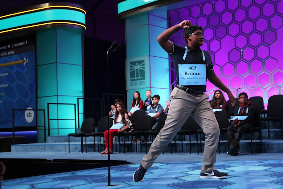 """NATIONAL HARBOR, MARYLAND - MAY 30: Rohan Raja of Irving, Texas, celebrates after he correctly spelled the word """"ferraiolone"""" during round eight of the Scripps National Spelling Bee at the Gaylord National Resort & Convention Center May 30, 2019 in National Harbor, Maryland. Students from across the country and around the world compete in the spelling competition, which started in 1925. (Photo by Alex Wong/Getty Images)"""