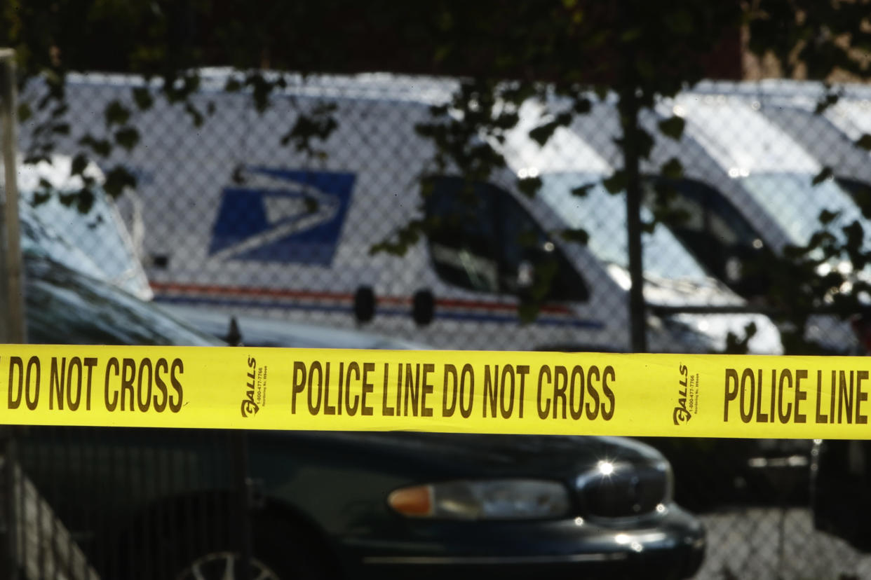 Police tape cordons off a post office in Wilmington, Del., on Thursday. (AP Photo/Matt Rourke)