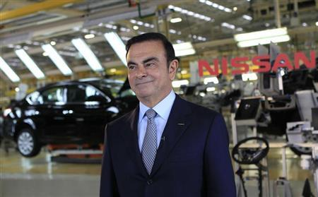Nissan CEO Ghosn smiles during an interview with Reuters at the company's new plant in Aguascalientes