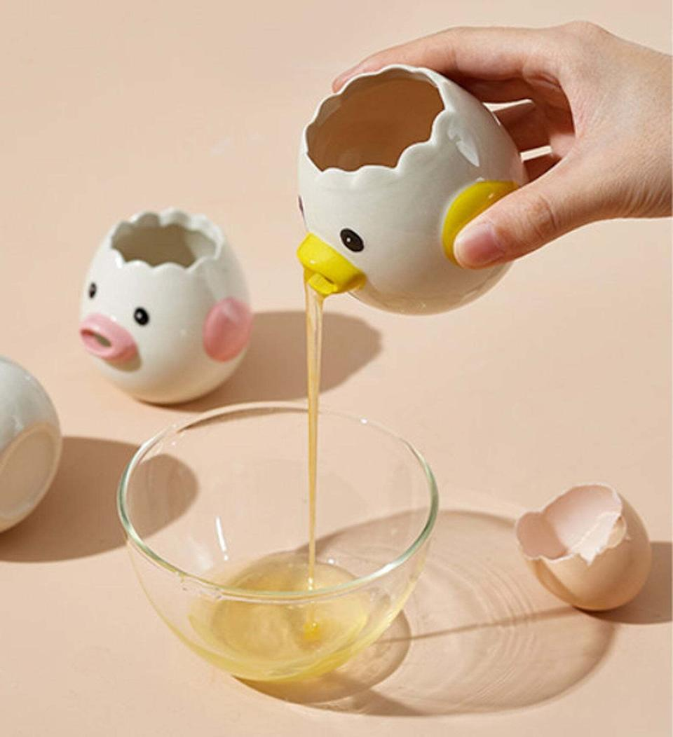 """You'll be so *egg-cited* to use this, whether you're prepping an omelet or baking a cake.<br /><br />BTW: Colorful Cotton Candy is a small business run out of Hong Kong.<br /><br /><strong>Promising review:</strong>""""Item was very well packaged, it was cute and well made. Can't wait to use it. 😍Candy, the seller, was fantastic at communicating/providing shipping updates. 🤩 Looking forward to seeing new products get added to the shop. Will be buying again with no hesitation."""" —<a href=""""https://go.skimresources.com?id=38395X987171&xs=1&url=https%3A%2F%2Fwww.etsy.com%2Fpeople%2Fo5twvadq&xcust=HPHandheldKitchenTools607ef55ae4b01bc7979c2797"""" target=""""_blank"""" rel=""""noopener noreferrer"""">Yvonne<br /></a><br /><strong>Get it from<a href=""""https://go.skimresources.com?id=38395X987171&xs=1&url=https%3A%2F%2Fwww.etsy.com%2Fshop%2FColorfulCottonCandy&xcust=HPHandheldKitchenTools607ef55ae4b01bc7979c2797"""" target=""""_blank"""" rel=""""noopener noreferrer"""">Colorful Cotton Candy</a>on Etsy for<a href=""""https://go.skimresources.com?id=38395X987171&xs=1&url=https%3A%2F%2Fwww.etsy.com%2Flisting%2F856556467%2Fegg-white-separator-egg-yolk-separator&xcust=HPHandheldKitchenTools607ef55ae4b01bc7979c2797"""" target=""""_blank"""" rel=""""noopener noreferrer"""">$12.07+</a>(available in four colors).</strong>"""
