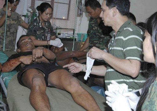 In this photo, released by the Philippine Army's Western Mindanao Command, a wounded soldier is treated at a hospital after a clash with the Moro Islamic Liberation Front (MILF) in Basilan on October 18. The Philippine military has accused Muslim rebels of killing 19 soldiers on a remote southern island in one of the worst outbreaks of violence between the two sides in years