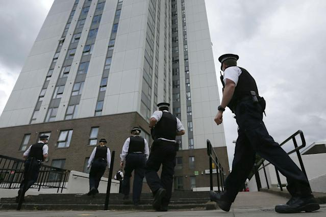 <p>Police officers outside Dorney Tower, part of the Chalcots Estate in the borough of Camden, north London, Sunday June 25, 2017. The apartments were evacuated after fire inspectors concluded that the buildings were unsafe because of problematic fire doors, gas pipe insulation, and external cladding similar to that blamed for the rapid spread of a fire that engulfed Grenfell Tower on June 14. (Photo: Tim Ireland/AP) </p>