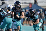 Coastal Carolina quarterback Grayson McCall (10) looks for a receiver during the first half of an NCAA college football game against Appalachian State, Saturday, Nov. 21, 2020, in Conway, S.C. (AP Photo/Richard Shiro)