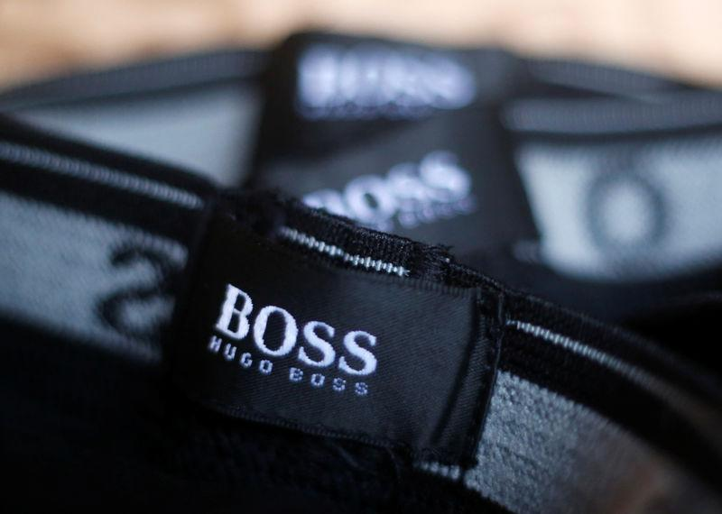 The logo of German fashion house Hugo Boss is seen on a clothing label at their outlet store in Mezingen near Stuttgart