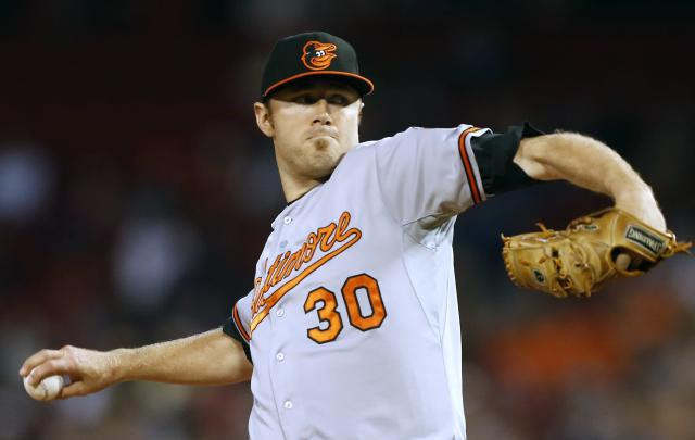 Baltimore Orioles' Chris Tillman pitches in the first inning of a baseball game against the Boston Red Sox in Boston, Thursday, Aug. 29, 2013. (AP Photo/Michael Dwyer)