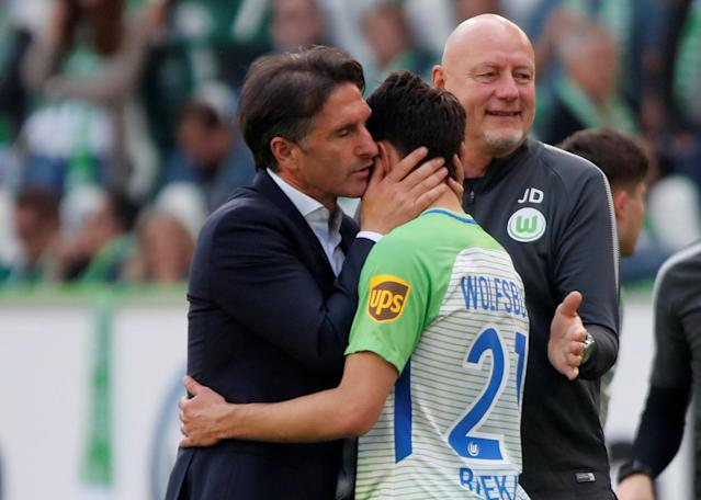 Soccer Football - Bundesliga - VfL Wolfsburg v FC Cologne - Volkswagen Arena, Wolfsburg, Germany - May 12, 2018 Wolfsburg coach Bruno Labbadia celebrates after the match with Josip Brekalo REUTERS/Wolfgang Rattay DFL RULES TO LIMIT THE ONLINE USAGE DURING MATCH TIME TO 15 PICTURES PER GAME. IMAGE SEQUENCES TO SIMULATE VIDEO IS NOT ALLOWED AT ANY TIME. FOR FURTHER QUERIES PLEASE CONTACT DFL DIRECTLY AT + 49 69 650050