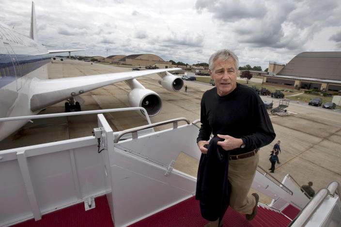 """FILE - In this Sept. 28, 2013, file photo U.S. Secretary of Defense Chuck Hagel boards his plane at Andrews Air Force Base, Md., en route to South Korea. Saturday, Oct. 5, 2013, the Pentagon ordered most of its approximately 400,000 furloughed civilian employees back to work. The decision by Hagel is based on a Pentagon legal interpretation of a law called the Pay Our Military Act. That measure was passed by Congress and signed by President Barack Obama shortly before the partial government shutdown began Tuesday, Oct. 1. The Pentagon did not immediately say on Saturday exactly how many workers will return to work, but use the term """"most"""". (AP Photo/Jacquelyn Martin, File)"""