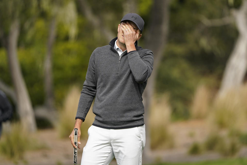 Jordan Spieth reacts after missing an eagle putt on the second green of the Pebble Beach Golf Links during the final round of the AT&T Pebble Beach Pro-Am golf tournament Sunday, Feb. 14, 2021, in Pebble Beach, Calif. (AP Photo/Eric Risberg)