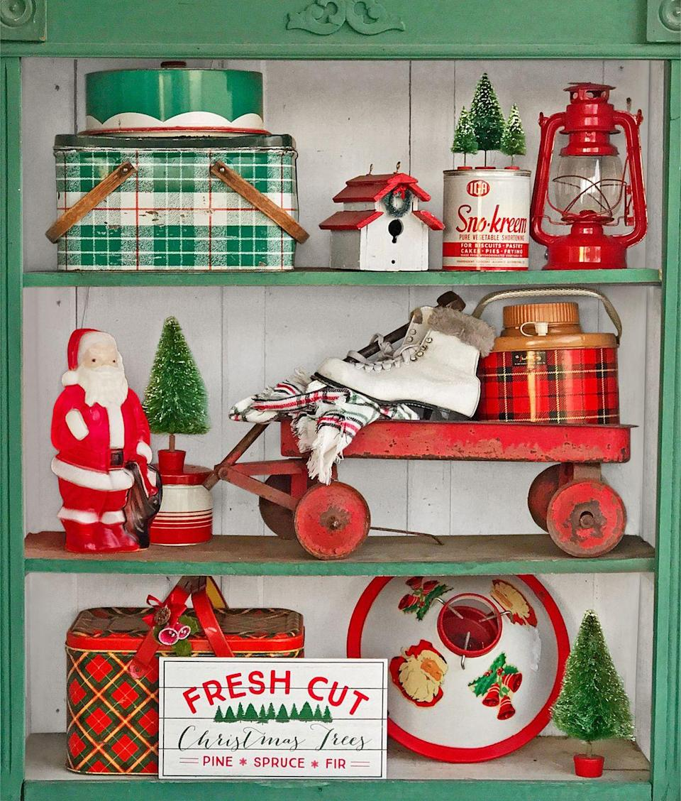 """<p>Non-seasonal items in red and green colors can be used to spiff up any area of your home—and they don't have to be intended to be used at Christmastime! Here, camp lanterns, decoware tins, coolers, and more are used to liven up a simple set of shelves.</p><p><a class=""""link rapid-noclick-resp"""" href=""""https://www.amazon.com/Radio-Flyer-Little-Red-Wagon/dp/B00L5LDWP8?tag=syn-yahoo-20&ascsubtag=%5Bartid%7C10050.g.1247%5Bsrc%7Cyahoo-us"""" rel=""""nofollow noopener"""" target=""""_blank"""" data-ylk=""""slk:SHOP RED WAGONS"""">SHOP RED WAGONS</a></p>"""