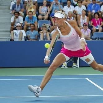 Czech Republic's Andrea Hlavackova returns a shot to Russia's Maria Kirilenko in the third round of play at the 2012 US Open tennis tournament, Saturday, Sept. 1, 2012, in New York. (AP Photo/Paul Bereswill)