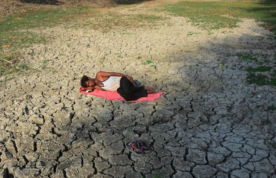 An indian local man takes resr on parched area of shrunken Varuna River during a hot day, in Phoolpur , some 45 kms from Allahabad on June 8, 2019. Much of India has been suffering from a heat wave for weeks along with a severe drought that has decimated crops, killed livestock and left at least 330 million Indians without enough water for their daily needs. (Photo by Ritesh Shukla ) (Photo by Ritesh Shukla/NurPhoto via Getty Images)