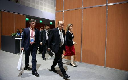 Brazil's Finance Minister Henrique Meirelles arrives for a news conference at the G20 Meeting of Finance Ministers in Buenos Aires, Argentina, March 19, 2018. REUTERS/Marcos Brindicci