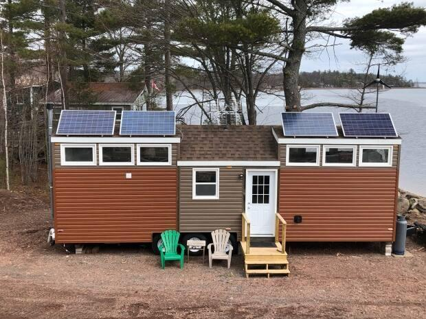 The tiny home is 450 square feet, which includes two loft bedrooms.  (Gary Moore/CBC - image credit)