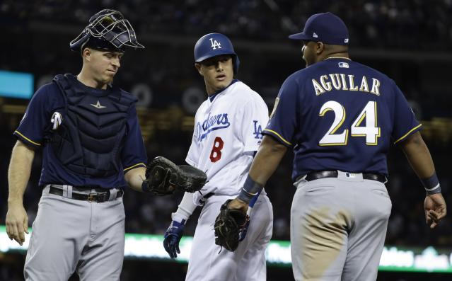 Manny Machado was fined for making contact with Jesús Aguilar. (AP Photo)