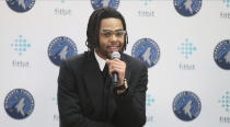 New Minnesota Timberwolves NBA basketball player D'Angelo Russell addresses the media after he was introduced, Friday, Feb. 7, 2020, in Minneapolis, following a trade that sent Timberwolves' Andrew Wiggins to the Golden State Warriors. (AP Photo/Jim Mone)