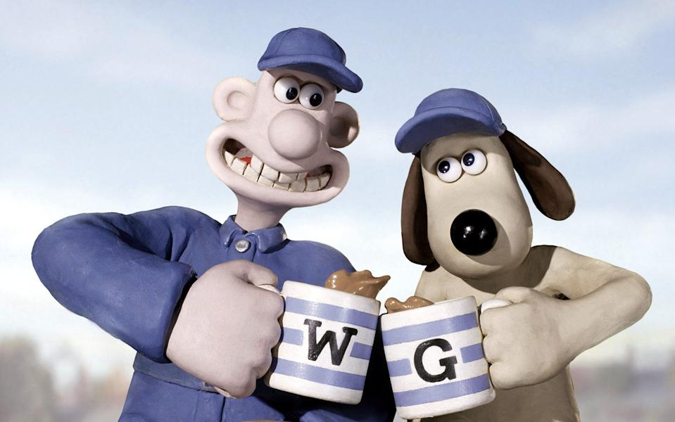 """In this photo provided by DreamWorks, Wallace and Gromit are cashing in with their humane pest-control outfit in """"Wallace & Gromit: The Curse of the Were-Rabbit.""""  (AP Photo/DreamWorks)"""