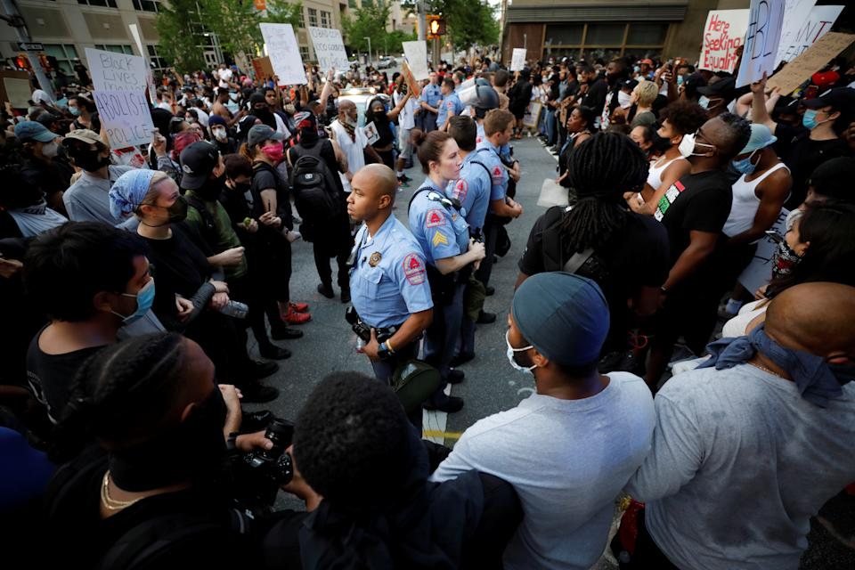 Protesters completely surround a line of police officers during nationwide unrest following the death in Minneapolis police custody of George Floyd, in Raleigh, North Carolina, U.S. May 30, 2020. Picture taken May 30, 2020. REUTERS/Jonathan Drake