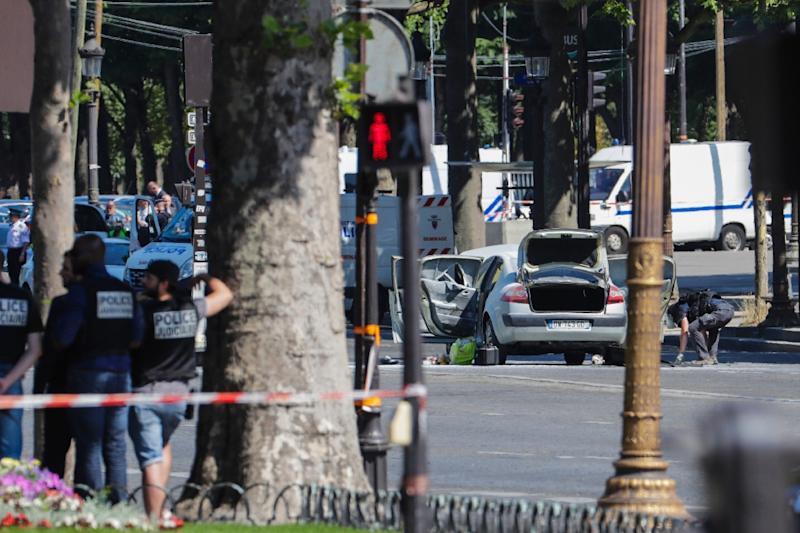 Authorities quickly sealed off the world-famous Champs-Elysees avenue after a 31-year-old man on a jihadist watchlist rammed a car loaded with guns and a gas bottle into a police (AFP Photo/Thomas SAMSON)