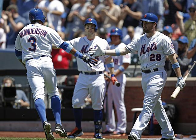 New York Mets' David Wright (5) and Daniel Murphy (28) greet teammate Curtis Granderson (3) at the plate after Granderson hit a first-inning solo home run off San Diego Padres starting pitcher Ian Kennedy during a baseball game in New York, Sunday, June 15, 2014. (AP Photo/Kathy Willens)