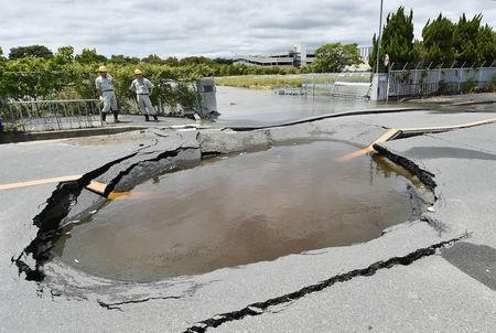 A water-filled crack on a road after water pipes were broken due to an earthquake is seen in Takatsuki, Osaka prefecture, western Japan, in this photo taken by Kyodo June 18, 2018.   Mandatory credit Kyodo/via REUTERS ATTENTION EDITORS - THIS IMAGE WAS PROVIDED BY A THIRD PARTY. MANDATORY CREDIT. JAPAN OUT. NO COMMERCIAL OR EDITORIAL SALES IN JAPAN.