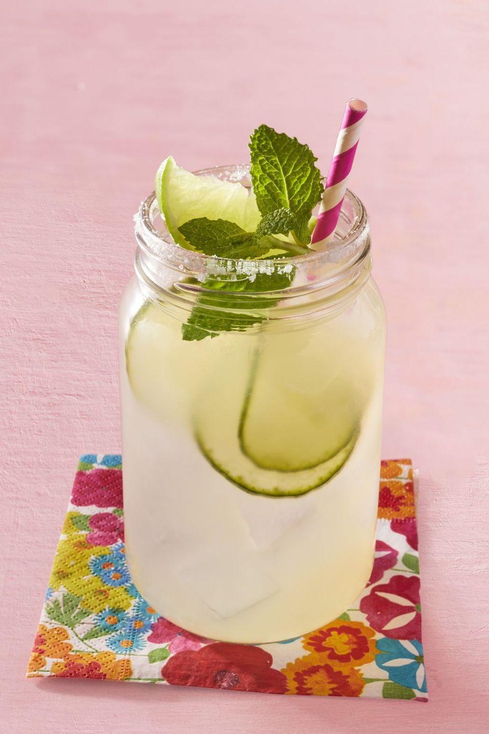 """<p>This is not your basic margarita recipe. It's bursting with the flavors of mint and cilantro, plus it has a fresh, cooling effect thanks to cucumber slices. You may never go back to plain margaritas again!</p><p><a href=""""https://www.thepioneerwoman.com/food-cooking/recipes/a32303003/margareeta-recipe/"""" rel=""""nofollow noopener"""" target=""""_blank"""" data-ylk=""""slk:Get Ree's recipe."""" class=""""link rapid-noclick-resp""""><strong>Get Ree's recipe.</strong></a></p><p><a class=""""link rapid-noclick-resp"""" href=""""https://go.redirectingat.com?id=74968X1596630&url=https%3A%2F%2Fwww.walmart.com%2Fsearch%2F%3Fquery%3Dpaper%2Bstraws&sref=https%3A%2F%2Fwww.thepioneerwoman.com%2Ffood-cooking%2Fmeals-menus%2Fg36432840%2Ffourth-of-july-drinks%2F"""" rel=""""nofollow noopener"""" target=""""_blank"""" data-ylk=""""slk:SHOP PAPER STRAWS"""">SHOP PAPER STRAWS </a></p>"""
