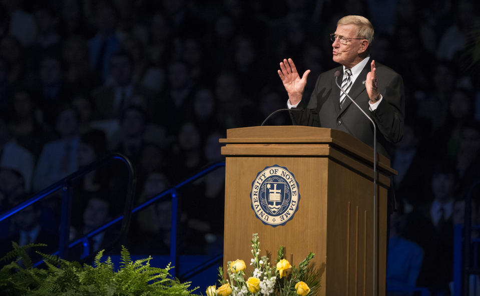 Former Notre Dame football coach Lou Holtz speaks during the memorial service for Rev. Theodore Hesburgh on Wednesday, March 4, 2015, inside the Purcell Pavilion at the University of Notre Dame in South Bend, Ind. (AP Photo/South Bend Tribune, Robert Franklin, Pool)