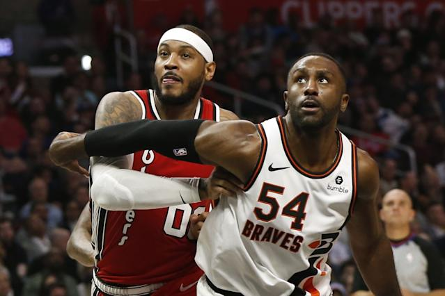 """Clippers forward Patrick Patterson guards Portland Trail Blazers forward Carmelo Anthony during a game on Dec. 3. <span class=""""copyright"""">(Katharine Lotze / Getty Images)</span>"""