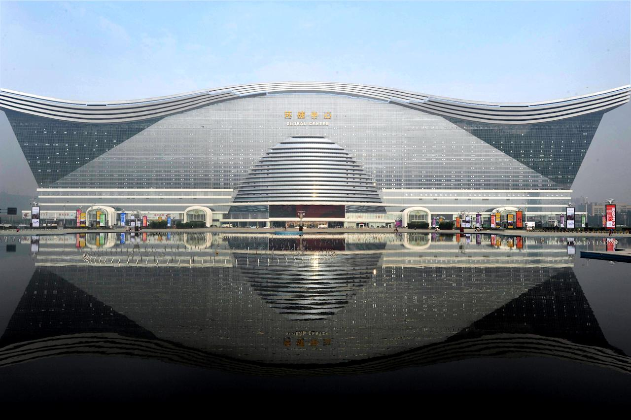 "The ""New Century Global Centre"" building opens to the public in Chengdu, southwest China's Sichuan province on June 28, 2013.  The center, claimed by Chinese officials to be ""the world's largest standalone structure"", measuring 500 metres in length and 400 metres in width, with 1.7 million square metres of floor space -- big enough to hold 20 Sydney Opera Houses -- is the latest symbol of China's economic boom.       CHINA OUT           AFP PHOTO"