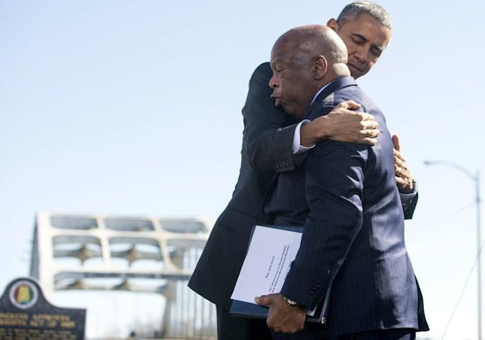 "President Obama hugs U.S. Rep. John Lewis (D-Ga.), one of the original 1965 marchers in Selma, at an event marking the 50th anniversary of what became known as Bloody Sunday. <span class=""copyright"">(Saul Loeb / AFP/Getty Images)</span>"