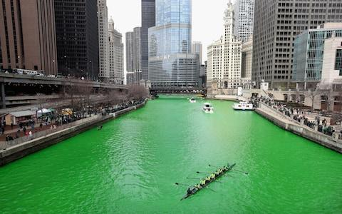 Rowers navigate the Chicago River shortly after it was dyed green in celebration of St. Patrick's Day on March 17, 2018 in Chicago, Illinois - Credit: Scott Olson/Getty Images