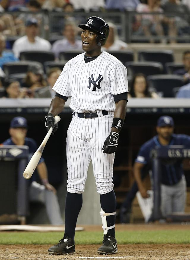 New York Yankees designated hitter Alfonso Soriano reacts after he was called out on strikes in the sixth inning of a baseball game at Yankee Stadium in New York, Tuesday, July 1, 2014. (AP Photo/Kathy Willens)