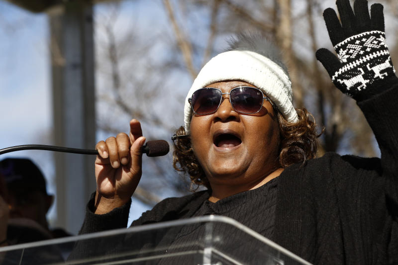 Jamie Scott leads a chant at a prison reform rally outside the Mississippi Capitol in Jackson, Miss., Friday, Jan. 24, 2020. Scott and her sister Gladys Scott, spent 16 years at the Central Mississippi Correctional Facility for a 1993 convenience store robbery. The rally protested dangerous and unhealthy prison conditions within the state prison system. A number o inmates have been killed in violent clashes in recent weeks at those facilities. (AP Photo/Rogelio V. Solis)