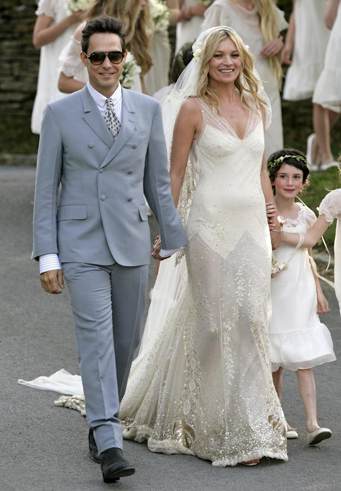 <p>We had to include two stylish brides from the year 2011. You can't look at Moss's hand-sequined and embroidered gown and tell us it's not iconic. She completed the look with a long, sparkling veil when she married Jamie Hince at St. Peter's Church in England on July 1. </p>