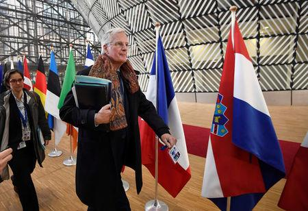 FILE PHOTO: EU Brexit negotiator Michel Barnier arrives at the EU summit in Brussels, Belgium, March 9, 2017.    REUTERS/Dylan Martinez/File Photo