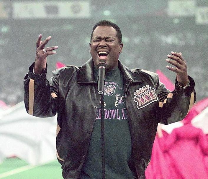 Singer Luther Vandross sings the US National Anthem at the Louisiana Superdome Jan. 27, 1997 before the start of Super Bowl XXXI in New Orleans, Louisiana. The Green Bay Packers playedthe New England Patriots in the Super Bowl.