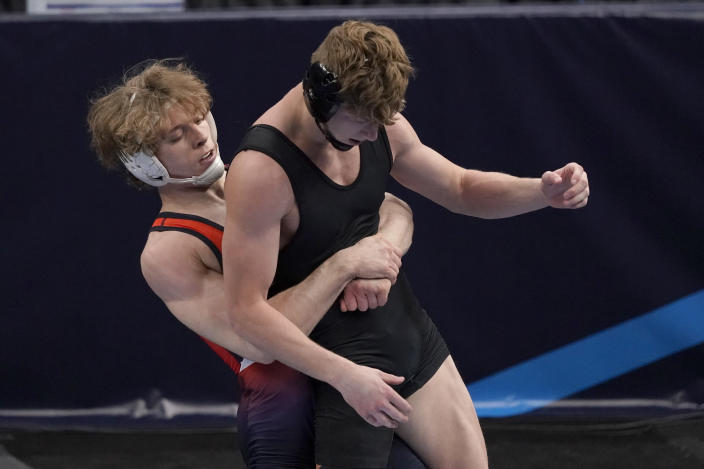 Bucknell's Zach Hartman, left, holds Stanford's Shane Griffith during their 165-pound match in the semifinal round of the NCAA wrestling championships Friday, March 19, 2021, in St. Louis. (AP Photo/Jeff Roberson)