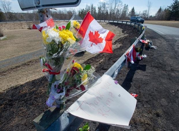 A memorial pays tribute to RCMP Const. Heidi Stevenson, a 23-year member of the force and mother of two, along the highway in Shubenacadie, N.S., on April 21, 2020.