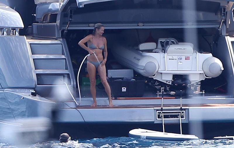 Kate Moss enjoys a holiday with friends on board a yacht in St-Tropez. Photo: Mega