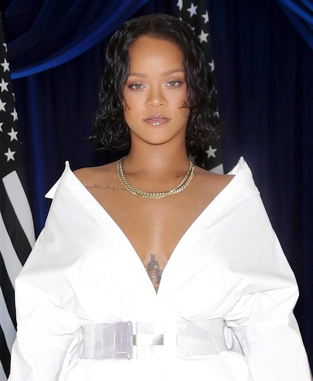 "<p>Rihanna looked angelic in an all-white ensemble, ""wet"" hair, and glossy nude lips at the Madeworn x Roc96 pop-up event. (Photo by Jerritt Clark/Getty Images) </p>"
