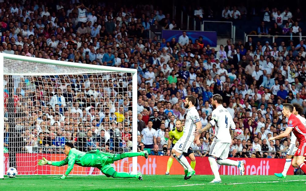 Real Madrid's Costa Rican goalkeeper Keylor Navas (L) tries to stop an own goal by Real Madrid's defender Sergio Ramos  - Credit: GETTY