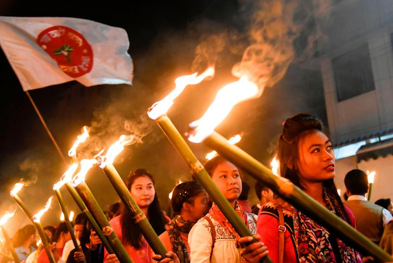 Activists of All Assam Students Union (AASU) take part in a torch light procession to protest against the government's Citizenship Amendment Bill, in Guwahati on December 8, 2019. (Photo: DAVID TALUKDAR via Getty Images)