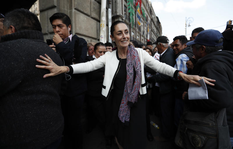 Mexico City's newly sworn in mayor, Claudia Sheinbaum, takes a walk to the Zocalo in Mexico City, Wednesday, Dec. 5, 2018. Sheinbaum is Mexico City's first elected female mayor. (AP Photo/Eduardo Verdugo)