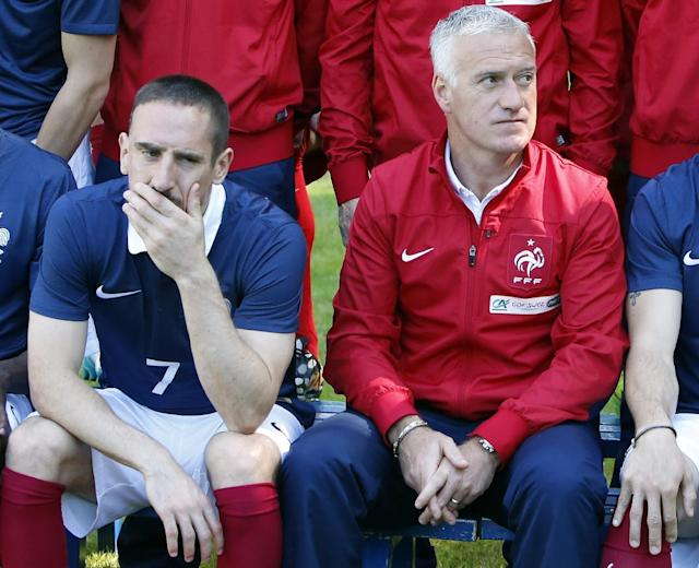 France's forward Franck Ribery, left and head coach Didier Deschamps pose for the team picture at the French national football team's training base, in Clairefontaine, outside Paris, Friday, June 6, 2014 as part of France's national football team's preparation for the upcoming FIFA 2014 World Cup in Brazil. (AP Photo/Francois Mori)