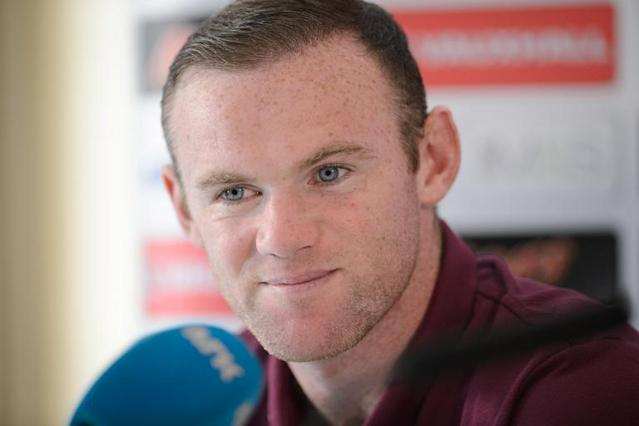 England captain Wayne Rooney takes questions from members of the media during a press conference in Watford on September 2, 2014 (AFP Photo/Leon Neal)