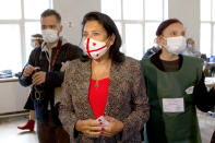 Georgia's President Salome Zurabishvili, center, wearing a face mask to help curb the spread of the coronavirus, speaks to journalists at a polling station during national municipal elections in Tbilisi, Georgia, Saturday, Oct. 2, 2021. Former President Mikheil Saakashvili was arrested after returning to Georgia, the government said Friday, a move that came as the ex-leader sought to mobilize supporters ahead of the national municipal elections seen as critical to the country's political makeup. The elections started Saturday. (AP Photo/Zurab Tsertsvadze)