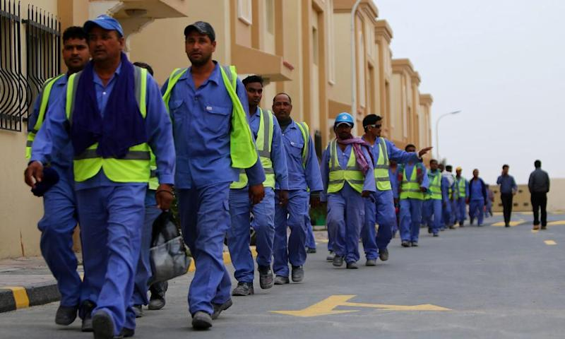 Foreign labourers return to their accommodation in Doha's Al-Wakrah suburbs.