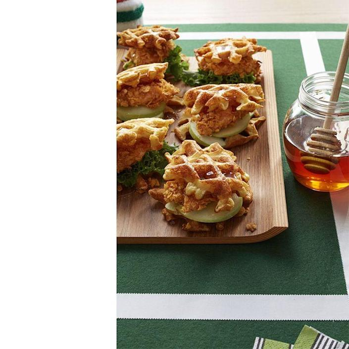"""<p>These sliders are the perfect fork-free way for Dad to eat this favorite Southern meal.</p><p><a href=""""https://www.womansday.com/food-recipes/food-drinks/recipes/a53335/chicken-and-buttermilk-waffles/"""" rel=""""nofollow noopener"""" target=""""_blank"""" data-ylk=""""slk:Get the Chicken and Buttermilk Waffles recipe."""" class=""""link rapid-noclick-resp""""><em>Get the Chicken and Buttermilk Waffles recipe.</em></a></p>"""