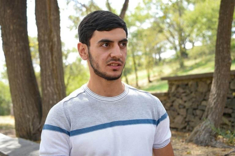 David Stepanyan narrowly escaped death on his first day fighting when an Azerbaijani shell blew up a car he had just got out of (AFP/Karen MINASYAN)