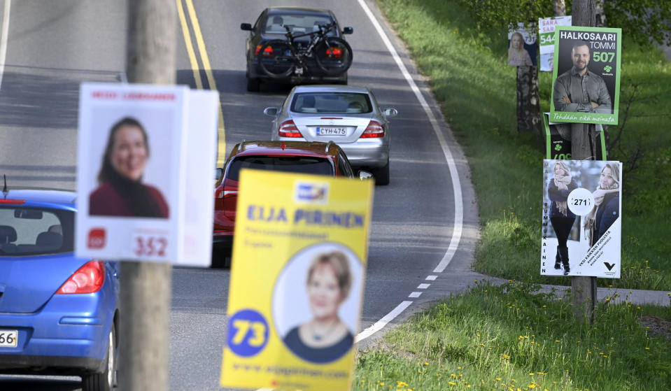 Campaign posters of the municipal elections on the roadside in Espoo, Finland, on May 25, 2021. Finland holds local elections upcoming Sunday June 13, 2021, in a first litmus test for the popular young Social Democratic prime minister, Sanna Marin, who took office a mere 18 months ago. (Heikki Saukkomaa/Lehtikuva via AP)
