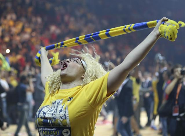 A Maccabi Tel Aviv supporter celebrates after her team won the Basket Euroleague Final Four semifinal match between CSKA Moscow, in Milan, Italy, Friday, May 16, 2014. Maccabi won 68-67. (AP Photo/Antonio Calanni)